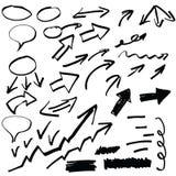 Insieme delle frecce disegnate a mano e di altri elementi,  Fotografia Stock