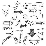 Insieme delle frecce disegnate a mano su fondo bianco Fotografia Stock