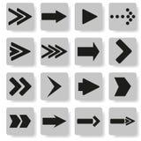 Insieme delle frecce su un fondo grigio Illustrazione di Stock