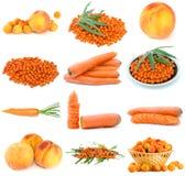 Insieme delle frutta, delle bacche e delle verdure arancioni Fotografia Stock