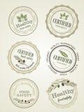 Insieme delle guarnizioni, sicurezza alimentare di logo, vettore Fotografia Stock