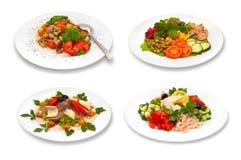 Insieme delle insalate su fondo bianco Fotografia Stock