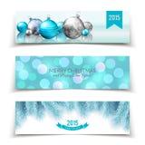 Insieme delle insegne del nuovo anno e di Natale con le palle, i rami dell'abete ed il fondo del bokeh Fotografia Stock