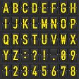 Insieme delle lettere su un orario meccanico Fotografia Stock Libera da Diritti
