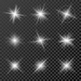 Insieme delle luci, delle stelle e delle scintille d'ardore su fondo trasparente nero Fotografie Stock Libere da Diritti