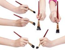 Insieme delle mani con i pennelli di arte con le punte nere Immagine Stock Libera da Diritti