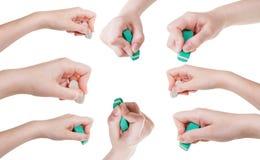 Insieme delle mani con la fine della gomma di gomma su isolate Fotografia Stock