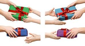 Insieme delle mani dei bambini con i presente Fotografia Stock