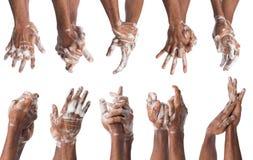 Insieme delle mani di lavaggio dell'uomo di colore isolate su fondo bianco Fotografie Stock