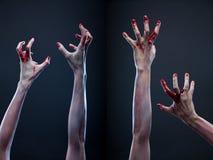 Insieme delle mani sanguinose dello zombie Fotografia Stock Libera da Diritti