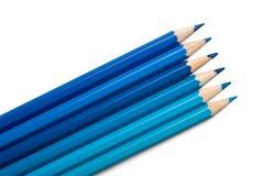 Insieme delle matite colorate, gamma di colori blu Immagine Stock
