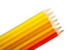 Insieme delle matite colorate, gamma di colori giallo arancione Fotografia Stock