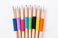 Insieme delle matite con i raccoglitori elastici Immagini Stock