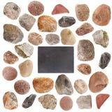 Insieme delle pietre isolate su fondo bianco Immagini Stock