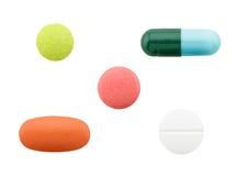 Insieme delle pillole isolate su fondo bianco Immagine Stock