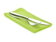 Insieme delle posate o dell'argenteria della forcella e del coltello sull'asciugamano Fotografie Stock