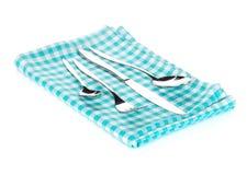 Insieme delle posate o dell'argenteria della forchetta, dei cucchiai e del coltello sull'asciugamano Fotografia Stock