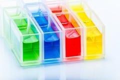 Insieme delle provette con il liquido di colore Immagine Stock