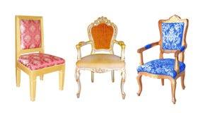 Insieme delle sedie isolate su bianco Fotografie Stock