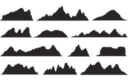 Insieme delle siluette in bianco e nero della montagna Confine del fondo delle montagne rocciose immagine stock libera da diritti