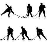 Insieme delle siluette del giocatore di hockey Isolato su bianco royalty illustrazione gratis