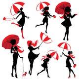 Insieme delle siluette delle ragazze con gli ombrelli, su backg bianco Fotografia Stock
