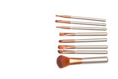 Insieme delle spazzole di trucco isolate su fondo bianco Fotografia Stock