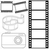 Insieme delle strisce di pellicola e del photocamera Fotografia Stock