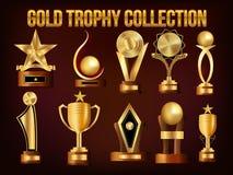 Insieme delle tazze e dei premi dorati del trofeo Fotografie Stock