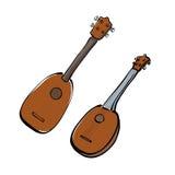Insieme delle ukulele disegnate a mano Immagini Stock
