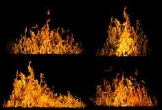 Insieme di alte fiamme gialle isolate sul nero Immagini Stock
