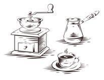 Insieme di caffè con il macinacaffè, la stampa della macchinetta del caffè ed il Cu manuali Fotografia Stock