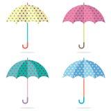 Insieme di Dots Umbrellas variopinto Immagini Stock