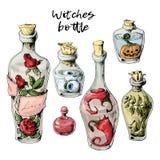 Insieme di Halloween delle bottiglie appassite con una pozione ed i trofei Fotografie Stock