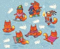 Insieme di inverno dei caratteri delle volpi nello stile del fumetto Immagine Stock