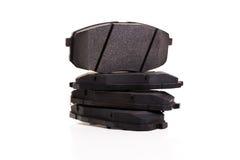 Insieme di nuovi cuscinetti di freno dell'automobile Immagini Stock Libere da Diritti