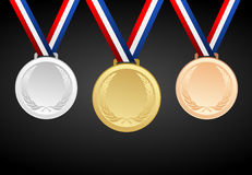 Insieme di oro, di argento e delle medaglie in bianco bronzee del premio con i nastri Fotografie Stock