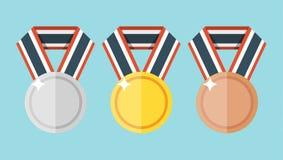 Insieme di oro, di argento e delle medaglie piane bronzee Fotografie Stock Libere da Diritti