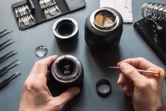 Insieme di riparazione dell'obiettivo della foto Manutenzione dell'ingegnere Fotografia Stock Libera da Diritti