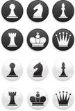 Insieme di scacchi in bianco e nero sui tasti rotondi Fotografia Stock