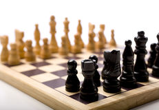 Insieme di scacchi su priorità bassa bianca Fotografia Stock Libera da Diritti