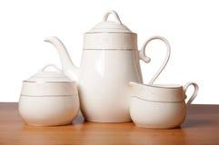 Insieme di tè della porcellana di osso isolato su bianco Immagini Stock Libere da Diritti