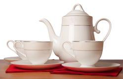 Insieme di tè della porcellana di osso isolato su bianco Immagini Stock