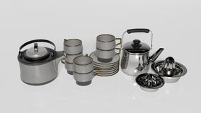 Insieme di tè, teiere con le tazze di tè, piattini e spremitoio del limone Fotografia Stock Libera da Diritti