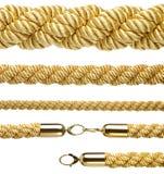 Insieme di varie corde dell'oro isolate su bianco Fotografia Stock Libera da Diritti