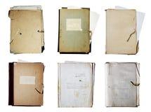 Insieme di vecchi dispositivi di piegatura con la pila di documenti Immagine Stock