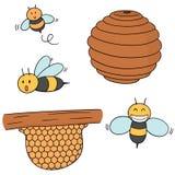Insieme di vettore dell'ape e del favo illustrazione di stock
