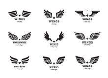 Insieme di vettore di logo della siluetta delle ali Disegno dell'annata Parte una Fotografia Stock