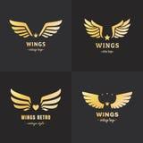 Insieme di vettore di logo delle ali dell'oro Progettazione d'annata dei pantaloni a vita bassa Parte due Immagini Stock