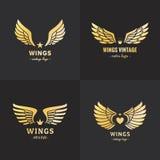 Insieme di vettore di logo delle ali dell'oro Progettazione d'annata dei pantaloni a vita bassa Parte una Fotografia Stock Libera da Diritti